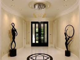 attractive foyer chandeliers in bubble lights and ceiling medallion with crown molding also front entry door tile flooring baseboard plus lighting