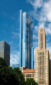 this slender 820 foot tall residential high rise and mixed use podium combines new construction of a luxury tower with preservation of historic masonry and
