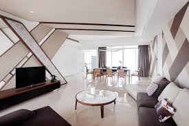 to conceal the electrical trunking in my living dining room my designer suggested a false ceiling of various heights it will cost us at least 5 000