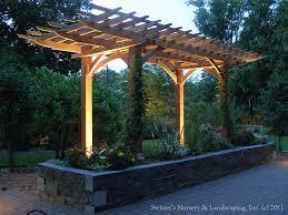 lighting a pergola. clay paver dinning patio with natural stone raised planter and cedar pergola uplighting on by switzeru0027s nursery u0026 landscaping vi lighting a c