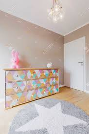 baby girl room chandelier. Baby Girl Room With A Colorful Commode, Deocrative Chandelier And Star Carpet Stock Photo - W
