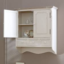 cream wall mounted cupboard with drawers lyon range