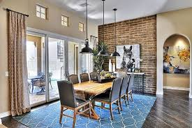 in a texturally rich dining room that bines contemporary and traditional styles the natural wood