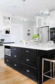 black kitchen island with black cup pull hardware
