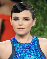 her cobalt blue and brown eye makeup paired with slick hair created a modern look