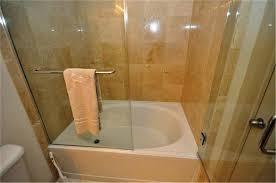image of sliding frameless glass bathtub doors