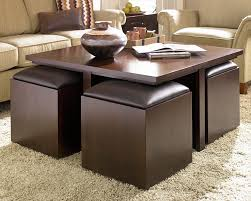 modern extra large black square coffee table with cubical shape black bench seat and white fur rug for living room
