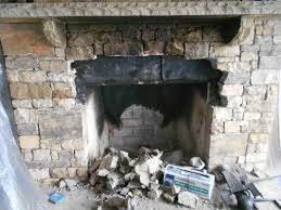 here you can see the fireplace with the arch removed we made a template of the arch and built a form so we could reuse the arch stones and keep the look