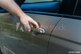 manu0027s hand opens the car door handle51 car