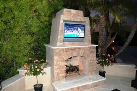 build your own outdoor fireplace designs with tv decorative plants in marble flooring