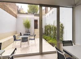 shot ned stainless steel skirting railings and glazed door frames