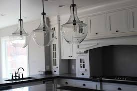 3 clear glass kitchen pendant lighting featuring large white kitchen cabinet