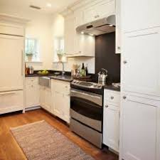 white galley kitchens. White Galley Kitchen With Honed Black Granite Countertops White Galley Kitchens R