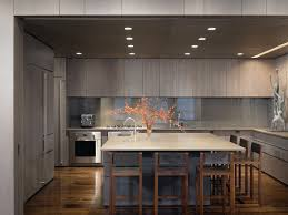 square recessed lighting with minimal under cabinet white cabinets breakfast bar