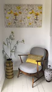 Vintage 60s/70s batik style cushion cover in yellow, styled with Ercol  chair,