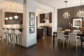 Paneled taupe accent wall echoes of the transitional kitchen cabinets of  the same color. Get