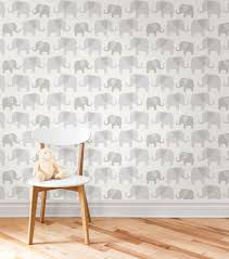 this pretty green and white baby wallpaper lends an enchanted storybook feel to a e the charming forest scene includes elegant trees and friendly birds