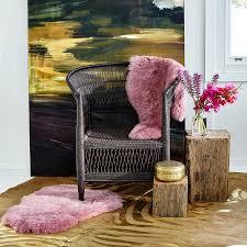 brown cowhide rug with gold metallic zebra print