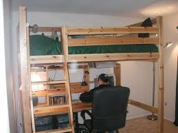 furniture brown wooden loft bed and green sheet with brown wooden board desk and black