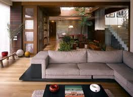 Appealinglivingroomdesignwithgreysofawoodenfloorblack - Amitabh bachchan house interior photos