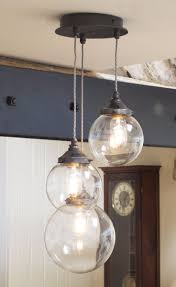 broadstones 3 light pendant light in natural black with antique bronze gallery fittings and cable