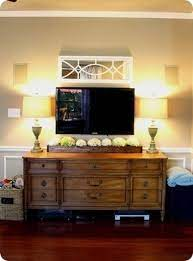 what to put under wall mounted tv