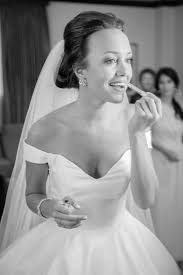 13 houston bride putting on makeup
