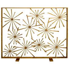 gilded steel studio made starburst fire screen by american artist del williams modern fireplace screenfireplace screensmodern fireplacesmid century