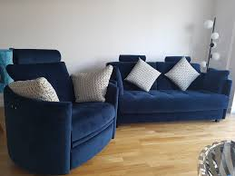 The curved armed chair and matching sofa bed cm wide with a double 140 cm x  195 cm mattress) were both covered in Warwick plush velvet  indigo.