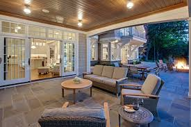 enclosed covered patio ideas patio beach style with white trim windows beach house wood lawn chair beach style patio furniture
