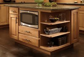 maple center island with under counter microwave cabinet and open end shelves