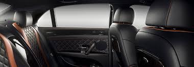black and orange leather rear cabin interior of a bentley flying spur w12 bentley motors