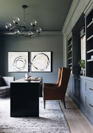 grey walls and bookcase with shelves and cupboards large brown armchair black desk office design ideas tall