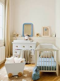 beige and blue small space baby nursery