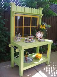 custom potting bench painted with green color with mirror with yellow frame flower vase and towel holder ideas outdoor potting bench with storagepotting