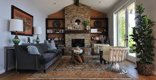 fireplace accent wall living room transitional with sloped ceiling cream leather chairs stone fireplace