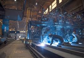 Welders monitor a machine at Heartland Fabrication formerly known as  Brownsville Marine in Brownsville