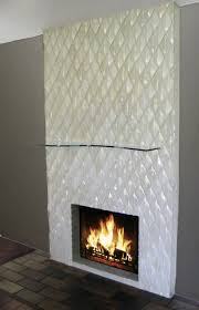 contemporary glass tile fireplace installation