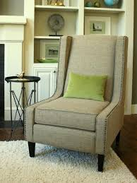 transitional taupe upholstered chair with nailhead trim