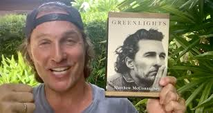 Matthew McConaughey with his book