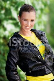 premium stock photo of teen girl in leather jacket