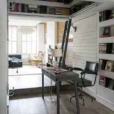 home office design ideas. home office in a corner with black desk and statement lamp design ideas