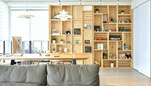 wood crate shelf this modern apartment interior features a wall of crates that become wooden bookshelf