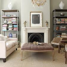 bookshelves fill nooks on either side of fireplace
