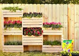 Give the old wooden fruit crates a new purpose. Just secure them together  and convert them into lovely vertical planters.
