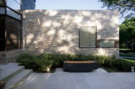 decorative stone wall exterior modern with corner windows entrance