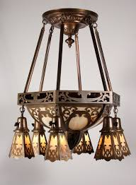 sold large antique brass eight light chandelier with original slag glass early 1900s