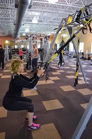 kathy quatrochi demonstrates a trx squat