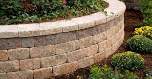 using retaining walls to create protection from erosion or manage sloped ground is a common choice in landscaping whether your design is out of necessity