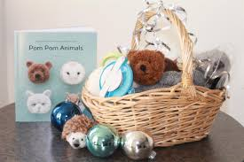 this book shown nov 11 2018 photo in concord n h features adorable pom pom s tuck it in a basket full of yarn and pom pom makers